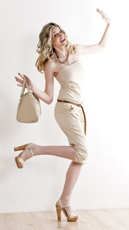 standing woman wearing summer clothes and shoes photo