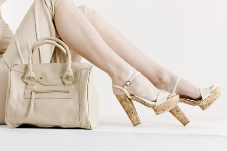 handbags: detail of sitting woman wearing summer clothes and shoes with a handbag