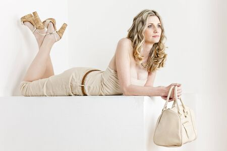 handbags: lying woman wearing summer clothes and shoes with a handbag Stock Photo