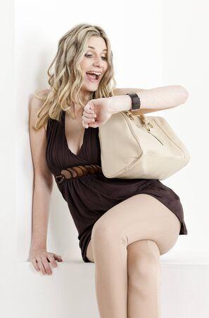 wristwatch: portrait of woman looking at wristwatch Stock Photo