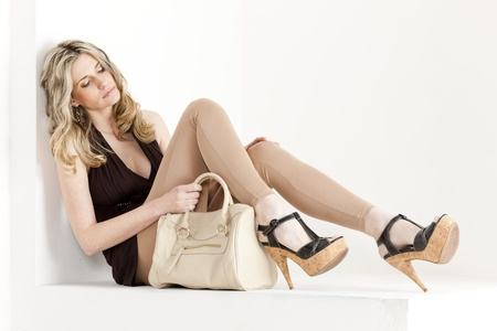 long pants: sitting woman wearing summer clothes and shoes with a handbag