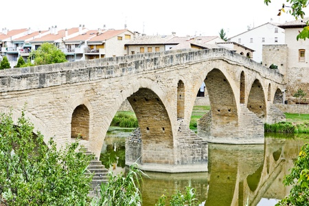romanesque bridge over river Arga, Puente La Reina, Road to Santiago de Compostela, Navarre, Spain Stock Photo - 9863428