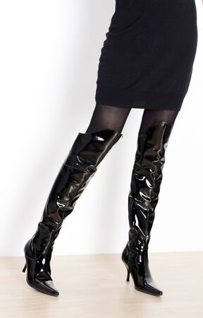 detail of standing woman wearing fashionable boots photo