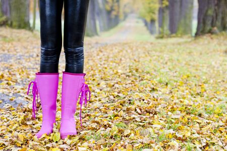 wellingtons: detail of woman in autumnal nature