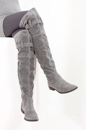detail of sitting woman wearing fashionable gray boots Stock Photo - 10420566