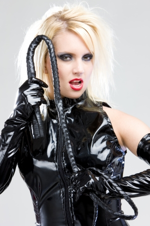 dominance: woman in latex with whip Stock Photo