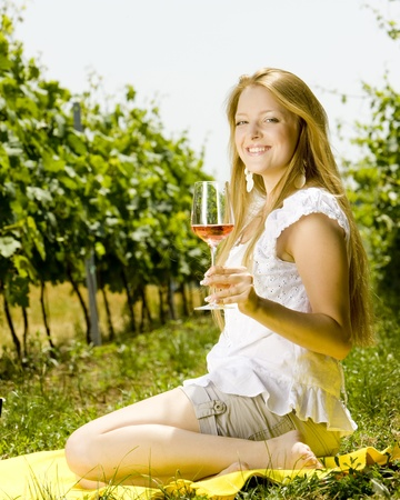 freetime: woman at a picnic in vineyard