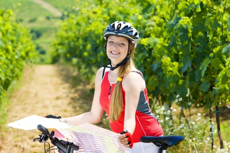 biker holding a map in vineyard, Czech Republic Stock Photo - 10479666