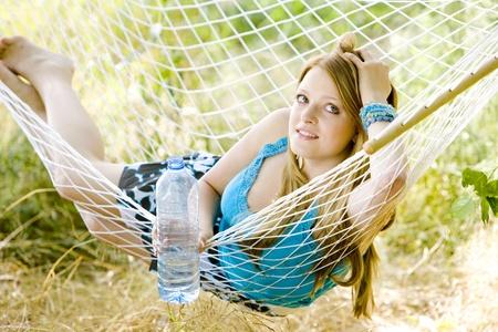 woman resting in hammock photo
