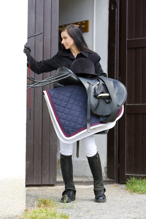 dark haired woman: equestrian with saddle