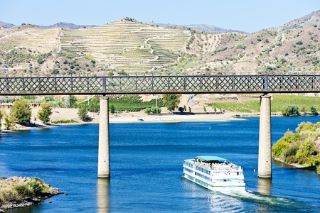 douro: railway viaduct and cruise ship in Pocinho, Douro Valley, Portugal