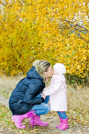 mother with her daughter in autumnal nature photo