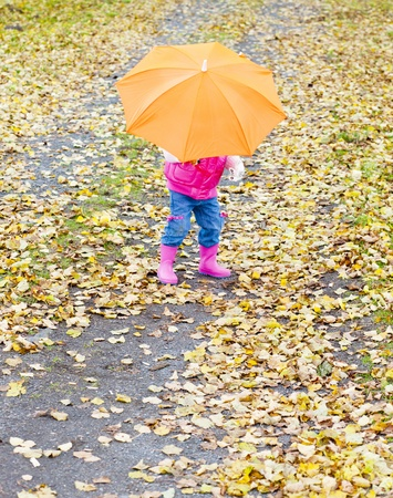 falltime: little girl with umbrella