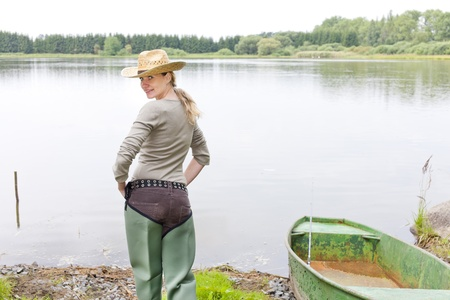 fisherwoman: fisherwoman at pond