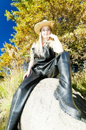 fisherwoman: fisher woman sitting on stone