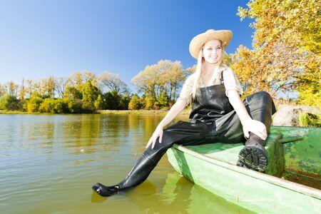 fisherwoman: fisher woman sitting on boat