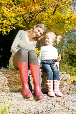 mother with her little daughter in autumnal nature photo