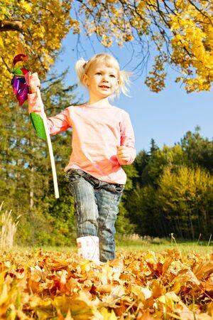 vane: little girl holding a vane