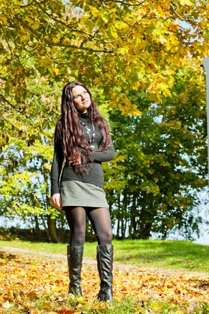 young woman in autumnal nature photo