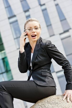 telephoning: portrait of telephoning young businesswoman