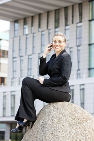 telephoning: telephoning young businesswoman
