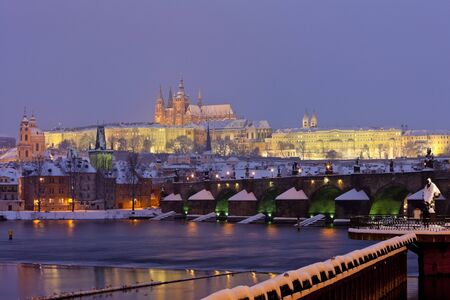 Hradcany with Charles bridge in winter, Prague, Czech Republic photo