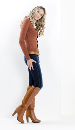 standing woman wearing fashionable brown boots photo