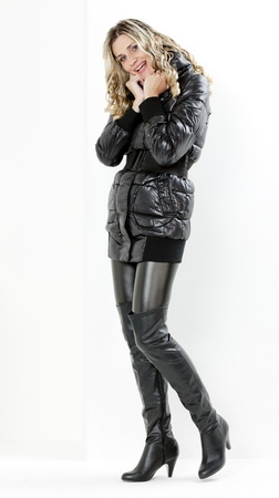 boots: standing woman wearing black clothes and black boots