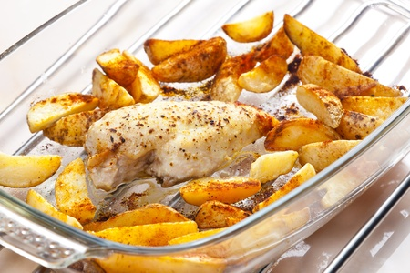 turkey meat on pepper baked with American potatoes photo