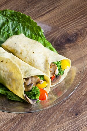 chicken meat: tortilla filled with chicken meat and vegetables Stock Photo