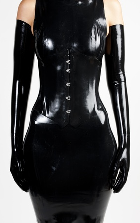 latex woman: detail of woman wearing latex clothes