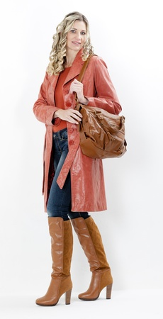 woman wearing fashionable brown boots with a handbag photo