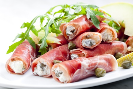 roquette: Parma ham rolls filled with cream cheese, Galia melon and capers