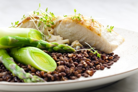 butterfish with green lentils, leek and green asparagus Stock Photo