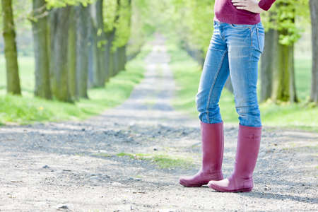 detail of woman wearing rubber boots photo