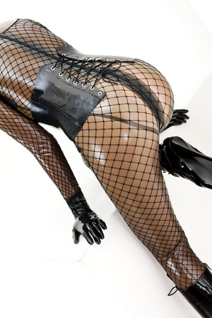 detail of kneeling woman wearing latex clothes photo