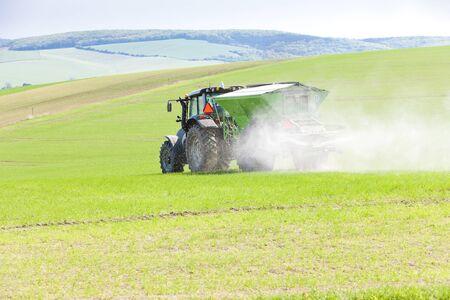farm implements: tractor on field, Czech Republic