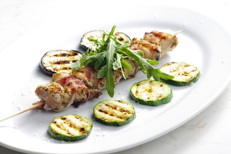 turkey skewer with bacon and grilled vegetables
