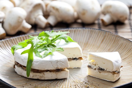 roquette: cheese brie filled with roasted mushrooms Stock Photo