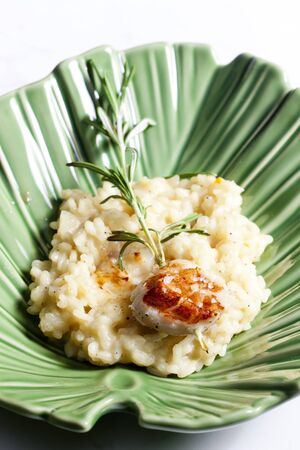 jacques: grilled Saint Jacques mollusc on rosemary needle with risotto