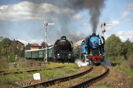 steam trains from Krupa station, steam locomotive called Parrot 477.043 and locomotive 464.102, Czech Republic Stock Photo - 13512797