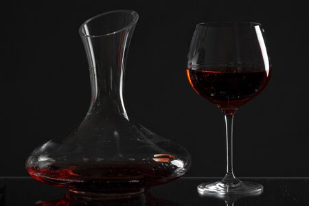carafe: wine glass and carafe with red wine