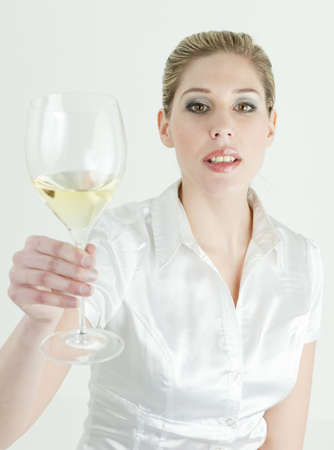 portrait of young woman with a glass of white wine photo