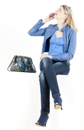 sitting woman with mobile phone and handbag Stock Photo - 13676690