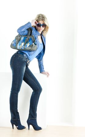 standing woman wearing blue clothes with handbag Stock Photo - 13676692