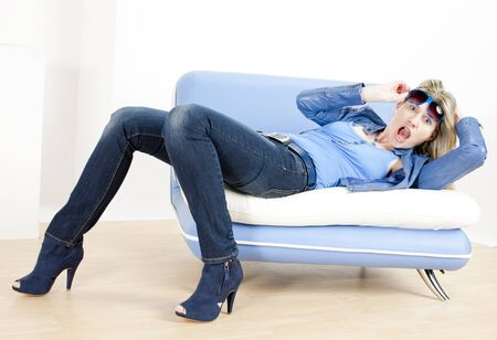 woman wearing blue clothes lying on sofa Stock Photo - 13676737