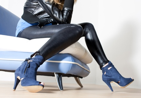 detail of woman wearing blue shoes photo