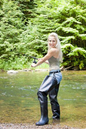 fisherwoman: woman fishing at river Stock Photo
