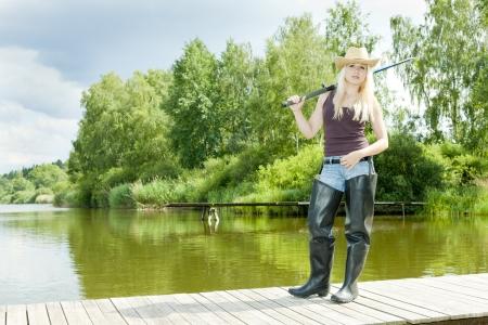 fishing woman standing on pier photo