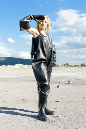 standing woman wearing protective clothes photo